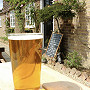 A pint of beer on a table outside the Frog and Nightgown